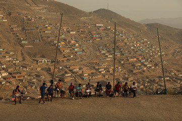 The Wider Image: In Peru, a soccer field unites shantytown community