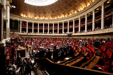 French ministers and members of parliament leave the questions to the government session prior to the vote for the French government's SNCF reform bill at the National Assembly in Paris