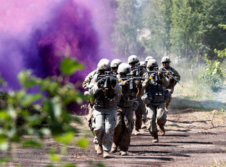 U.S. soldiers take part in the urban fighting drill during the NATO Saber Strike exercise in the Soviet-time former military town near Skrunda
