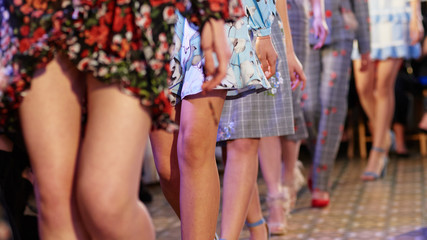 Fashion models showing new clothes collection at fashion week Wall mural