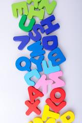Colorful letter blocks scattered randomly on white