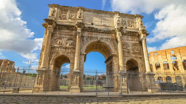 sunset with clouds   of Arch of Constantine, located between Colosseum and the Arch of Titus on the Roman road, built to celebrate the triumph of the emperor Constantine. Rome, Italy.