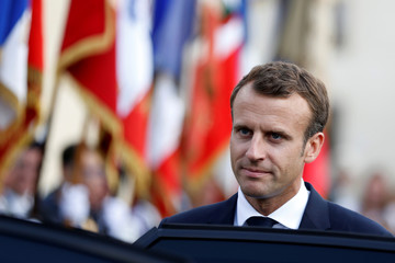 French President Emmanuel Macron leaves after a ceremony at the tomb of Georges Clemenceau (1841-1929), a major contributor to the Allied victory in WWI, in Mouchamps in Vendee