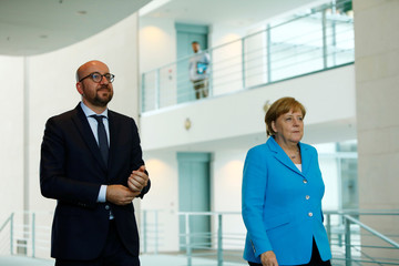 German Chancellor Angela Merkel and Belgium's Premier Charles Michel arrive for a news conference in Berlin
