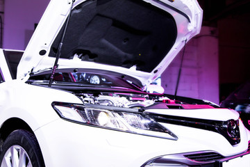 car with open hood