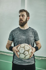 Portrait of indoor soccer player holding the ball
