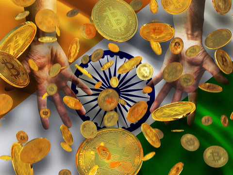 Bitcoin crypto currency India flag A lot of falling  gold bitcoins Rain of golden coins fall to the palms of the hands on Republic of India waving flag  background