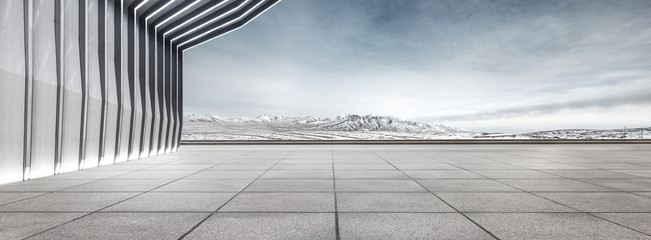 Fototapete - modern building and empty floor with skyline