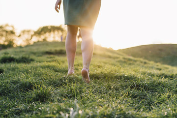walk barefoot on the grass at sunset