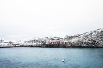 Pier of Red house located on the coast of Sakrisoy Village in Lofoten Island,Norway / Winter time