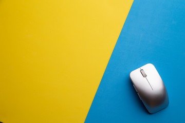 computer mouse in colorful background