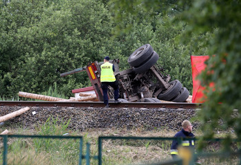 The site of a crash of a train and a truck carrying wood is pictured near Daleszewo Gryfinskie
