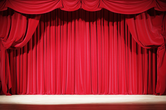 The interior of the old theater with red velvet curtains