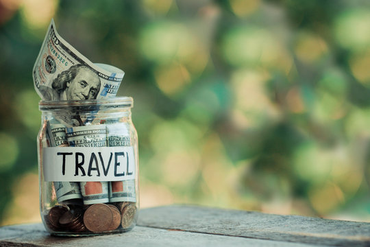 Dollars in a glass jar. Savings for travel.
