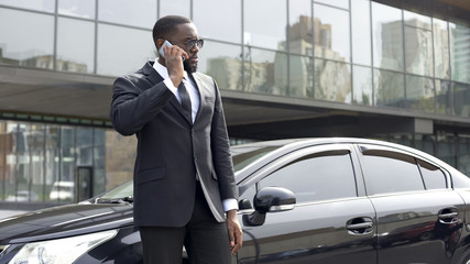 Detective of secret service receiving instructions by phone, security guard