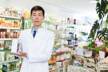 man pharmacist  is standing with medicine