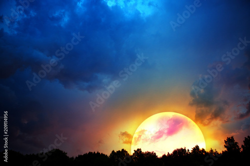 Big moon and colorful night sky background