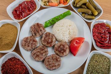 Turkish Food Kofte or Kofta / Stack of Meatballs with Rice Pilav