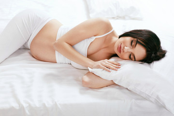 Pregnant Woman Sleep. Girl Sleeping With Pillow On Bed