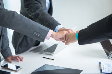 Business teamwork trust in team giving fist bump to greeting start up new project. Business partnership meeting with hands together. Teamwork Collaboration Relation Concept
