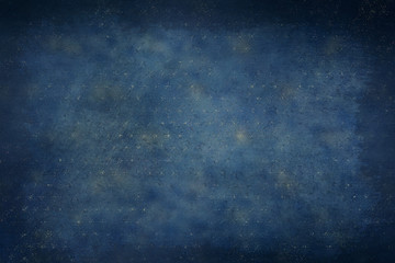 Navy blue and gold celestial stars background with dark vignette