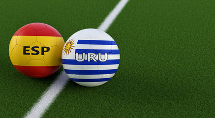 Spain vs. Uruguay Soccer Match - Soccer balls in Spain and Uruguyas national colors on a soccer field. Copy space on the right side - 3D Rendering