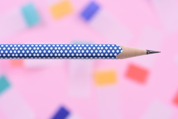 Single pencil on colorful blurred  background