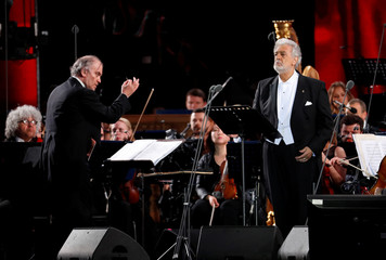 Russian conductor Valery Gergiev and Spanish tenor Placido Domingo perform during a gala concert, dedicated to the upcoming World Cup, in Moscow