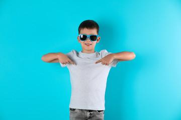Little boy in t-shirt on color background. Mock-up for design