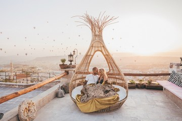 Romantic Couple watching a sunrise in a basquet in Cappadocia Wall mural