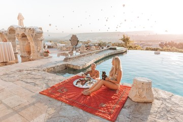 Romantic couple having breakfast at the pool in Cappadocia