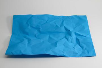 crumpled light blue paper