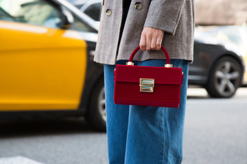 Detailed bag look shoot - Stylish short haired business woman commuting between meetings on a busy city