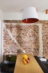 Contemporary dining room with brickwall