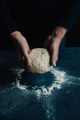Holding pizza dough