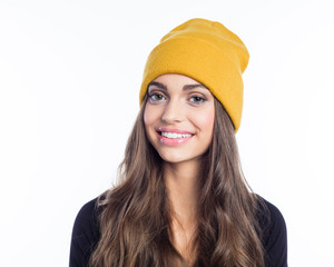 Happy long hair young woman in yellow beanie hat
