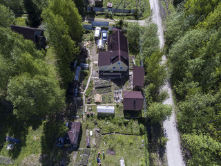 Country cottage area in forest, aerial view at Russian village at summer season