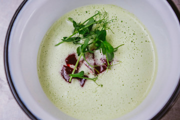 Parsley soup with red beet sauce