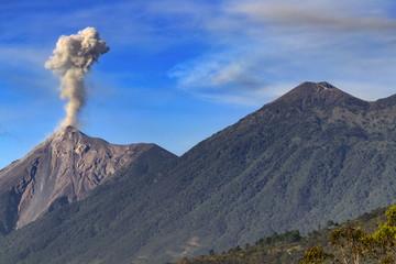 Guatemala. Antigua. Smoky, active Fuego volcano (Volcan Fuego) and dormant Acatenango