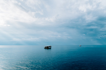 Rasdhoo Atoll, Green blue sea in Maldives with boat