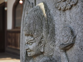 stone sculpture profile of buddha