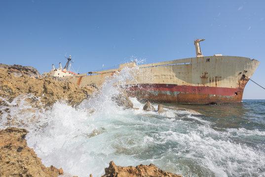 Ship wreck anchored on the sea shore