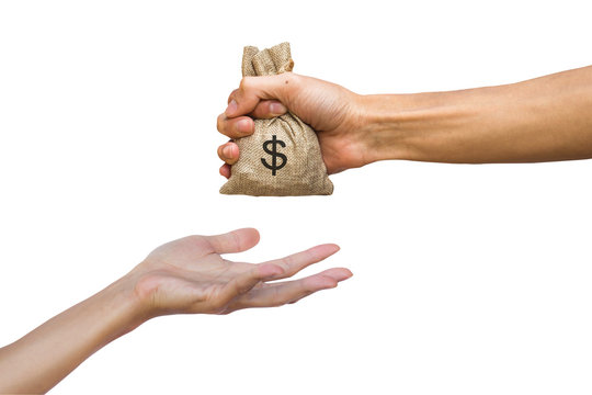 Hand holding money bag giving to another person isolated on white background with clipping path.