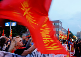 Protestors shout slogans against the change of the country's constitutional name in front of the Parliament building in Skopje