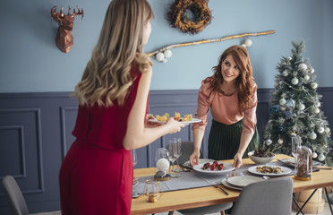 Woman Serving Food for Christmas Dinner