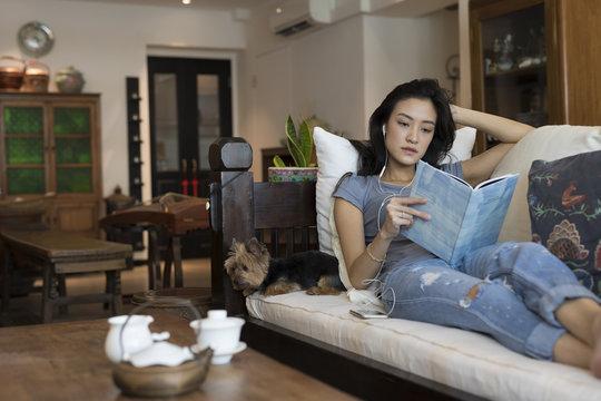 Singaporean woman on her sofa