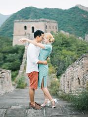 Elegant couple posing on wall