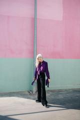 Stylish woman at street in light
