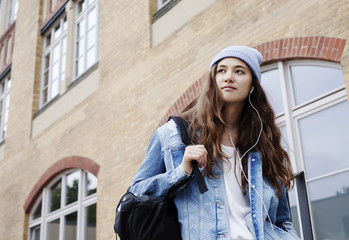 Cool young woman standing in front of her college.