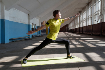 Yoga practice in sports hall